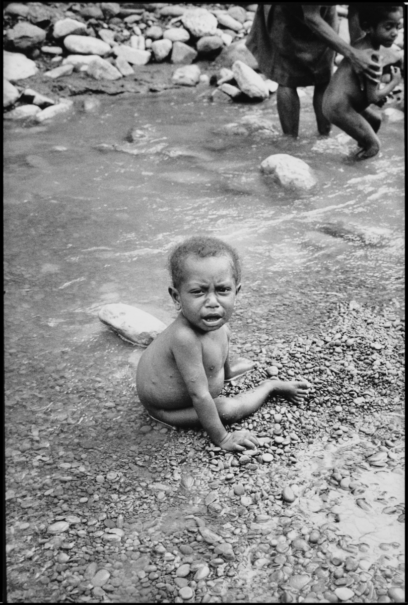 child in river